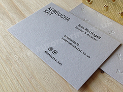 Black foil business cards printed on cool grey colorplan