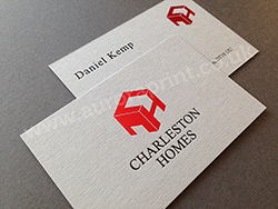 Black foil printed business cards with red foil on real grey colorplan.