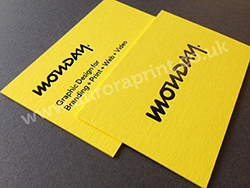 Black foil business cards printed on factory yellow colorplan
