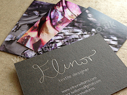 Colour printed business cards on duplexed stock.