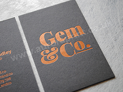 Satin copper foil printed business cards on dark grey card.