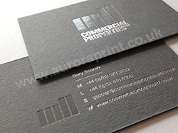 Clear foil debossing on a dark grey colorplan business card with silver foil print
