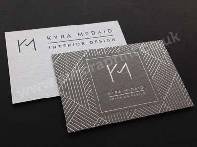 Duplexed grey and white colorplan business cards with foil print