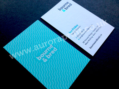 Turquoise and white duplexed business cards with foil print