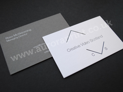 Duplexed business cards printed with white and black hot foil