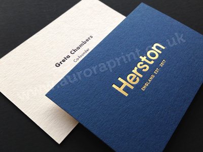 Duplexed cobalt and mist business cards with satin gold and black foil printing