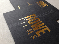 Matt black business cards printed with a metallic gold foil.