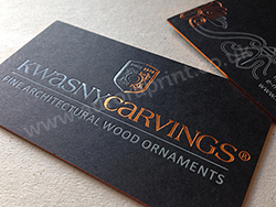 Matt black business cards with copper and grey foils and copper edges.