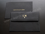 Black C6 envelope with gold foil printing.
